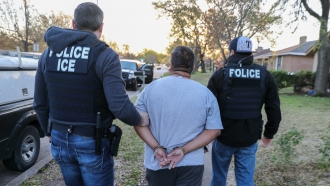 A file image of ICE agents detaining criminal aliens and immigration fugitives in 2018