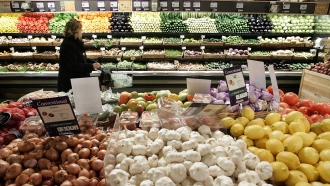 A woman shops in the produce section at Whole Foods January 13, 2005 in New York City.