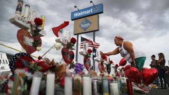 Woman visits memorial site at El Paso Walmart