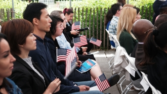 People participating in a naturalization ceremony