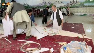 Aftermath of suicide bombing at Kabul wedding.