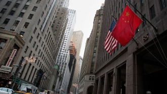 A Chinese flag flies next to a U.S. flag