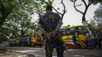 Guarded by Bangladesh military, bus arrives Thursday for repatriating Rohingya refugees to Myanmar.