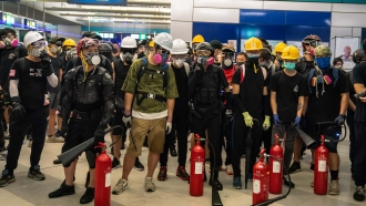 Protesters stand off against riot police during a protest at the Yuen Long MTR station on August 21, 2019 in Hong Kong
