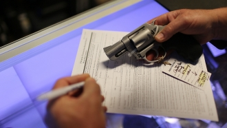 A man fills out his Federal background check paperwork.