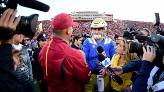 Then-UCLA quarterback Josh Rosen meets USC Head Coach Clay Helton after 2015 game at Los Angeles Memorial Coliseum.