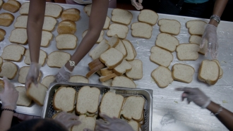 Volunteers prepare sandwiches