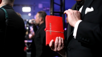 Man holds Oscar envelope for best picture.