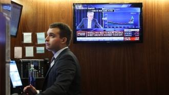 Trader monitors a screen