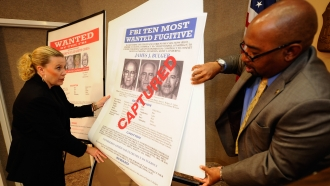 "A poster featuring Boston crime boss James ""Whitey"" Bulger at the Los Angeles Federal Building on June 23, 2011"
