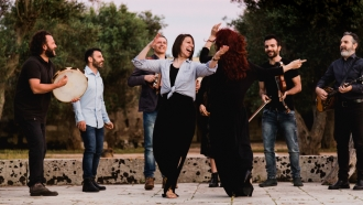 """Bare Feet"" host Mickela Mallozzi dances alongside Canzoniere Grecanico Salentino"