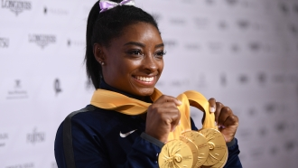 Simone Biles poses with gold medals