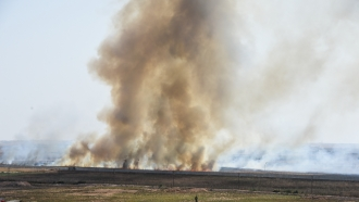 Smoke rises over Syrian town near Turkish border
