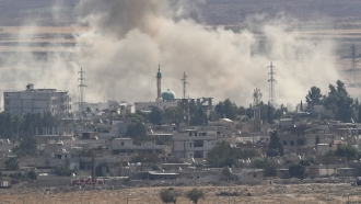 Smoke rises from Syrian town of Ras al-Ain amid Turkish offensive Oct. 15.