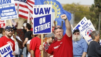 United Auto Workers members picket