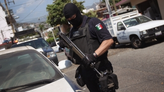 Mexican federal police officer on patrol in state of Guerrero.