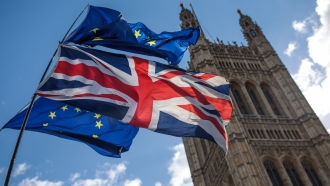 U.K. and EU flags outside British parliament