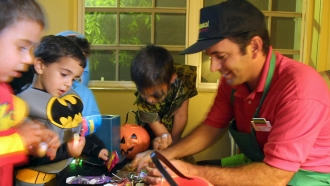 A man inspects his children's Halloween candy