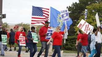 Striking United Auto Workers union members at the General Motors Detroit-Hamtramck Assembly Plant in Detroit, Michigan