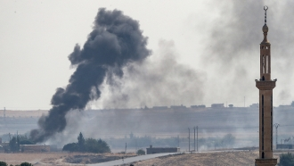 Smoke rises from a Syrian town near the border of Turkey