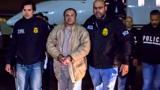 """El Chapo"" is handcuffed and escorted by ICE officers"