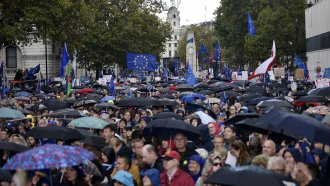 "Protesters gather on Parliament Street in the rain during the ""Together for the Final Say"" march on October 19, 2019 in Lond"