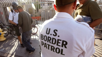 U.S. Border Patrol agents speaking with immigrants