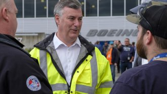 The now former Boeing Commercial Airplanes CEO Kevin McAllister talks with employees in 2018.
