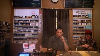 Smoke shop worker vaping