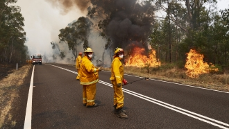 Fire crews work to control bush fires with back burns