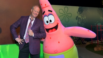 Actor Bill Fagerbakke poses with his character, Patrick Star