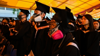 Students in gas masks at a campus protest