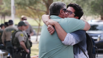 A father and son after the shooting at Saugus High School on Thursday, Nov. 14.