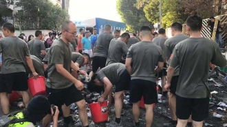Chinese troops clean up Hong Kong streets