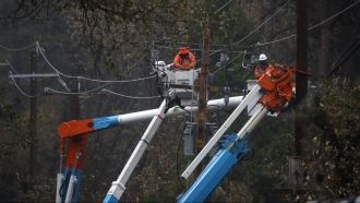 Pacific Gas & Electric Co. employees working on power lines
