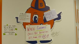 Signs supporting #NotAgainSU protesters at Syracuse University