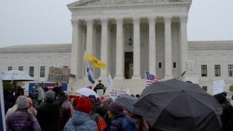 Demonstrators outside the Supreme Court