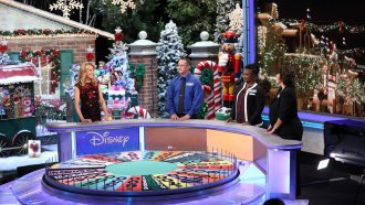 "Vanna White hosting ""Wheel of Fortune"" game show"