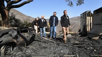 L.A. City Councilman Mike Bonin, California Gov. Gavin Newsom and L.A. City Mayor Eric Garcetti tour a burned home