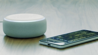 A smart speaker and cell phone can connect patients with health records and medical information.