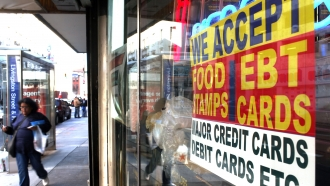 A sign advertising the acceptance of food stamps