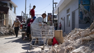 People inspect damage following earthquake in Puerto Rico