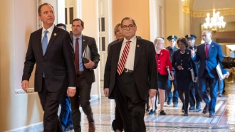 House impeachment managers walk to the Senate chamber
