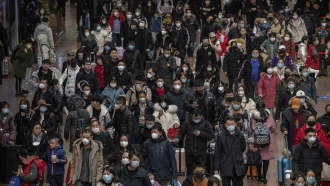 Chinese people wear masks to protect them from the coronavirus