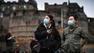 Tourists wearing medical face masks