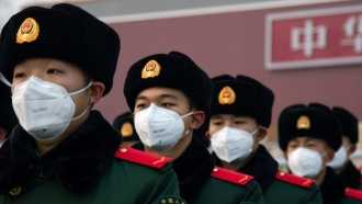 Chinese police officers wearing masks