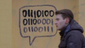 Man walks past a sign in Kiev, Ukraine.