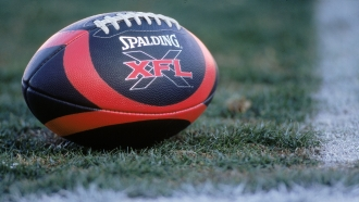 View of XFL football on the field.