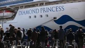 Media gather outside the quarantined Diamond Princess cruise ship in Yokohama, near Tokyo, Tuesday, Feb. 11, 2020