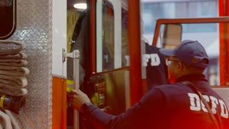 Firefighter approaches truck